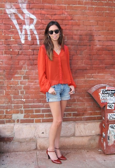 PopSugar NYC's Marisa Tom working a sheer blouse with denim cutoffs and cool textured pumps.
