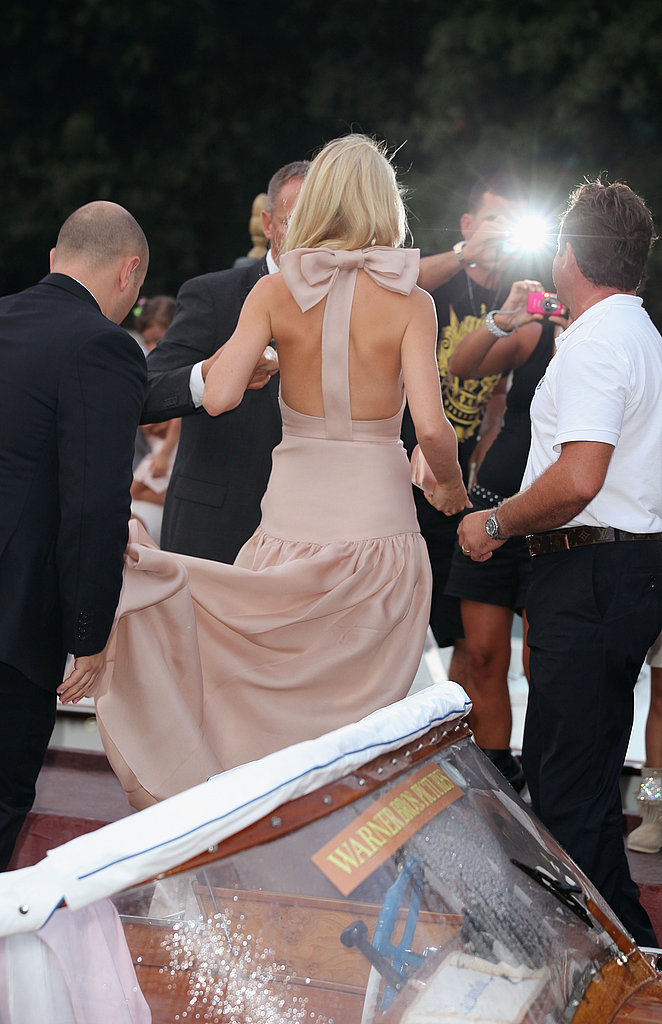 Gwyneth Paltrow arrives by boat at the Contagion premiere.