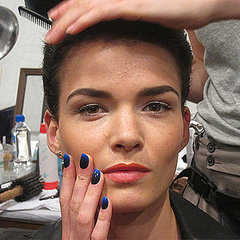 Models sported nail art that complemented ...