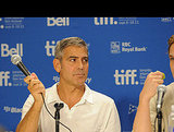 George Clooney threatened to beat Ryan with a microphone.