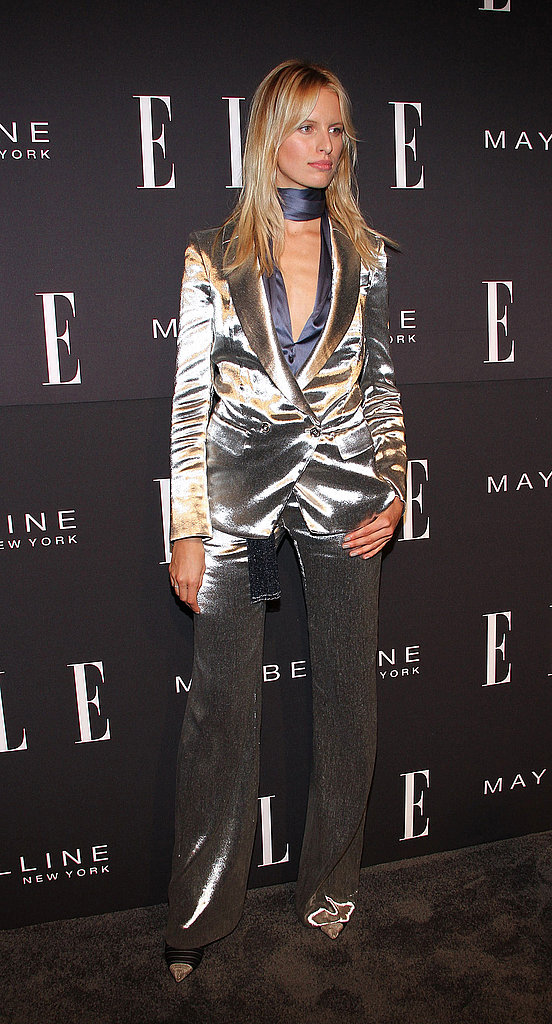 Karolina Kurkova suited up in a metallic suit for Elle's presentation.