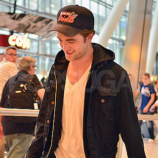Robert Pattinson Arrives at Heathrow With His Guitar Pictures
