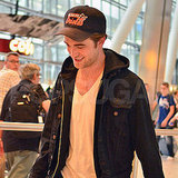 Robert Pattinson smiled while making his way through London's Heathrow airport.