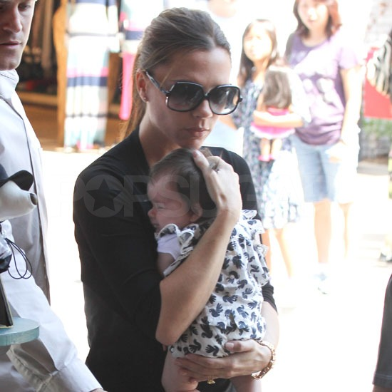 Victoria Beckham held little Harper close.