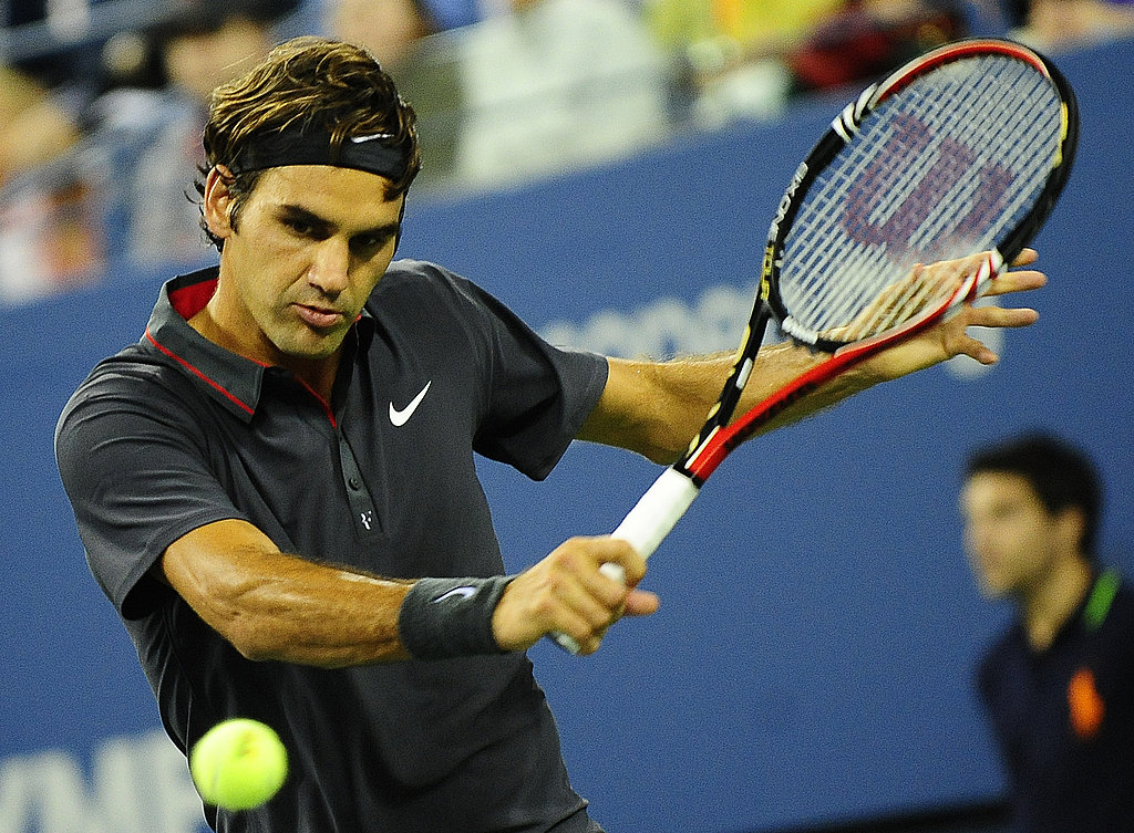 Swiss tennis player Roger Federer returns a shot to Argentina's Juan Monaco on Monday.