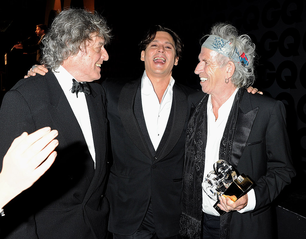 Johnny Depp laughs with Keith Richards and Tom Stoppard.