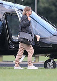 Brad Pitt lands in a helicopter.