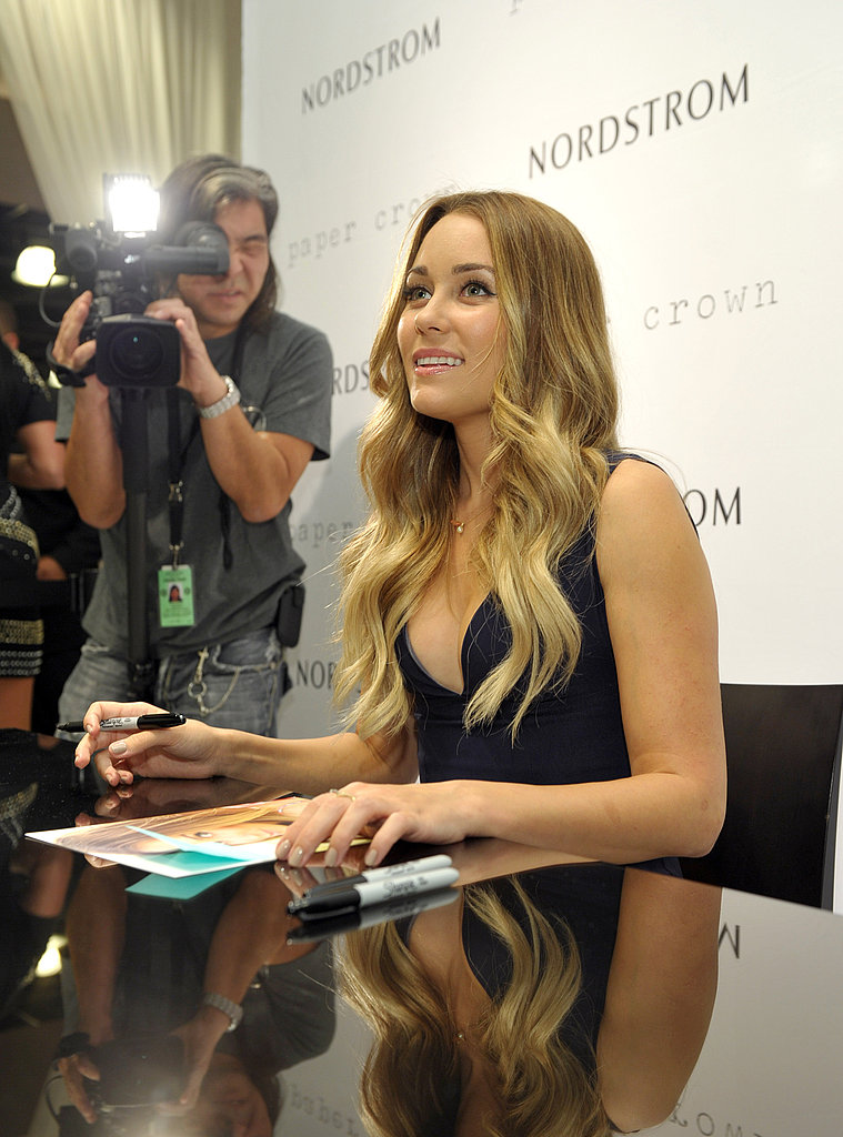 Lauren Conrad talked to a fan on Fashion's Night Out.
