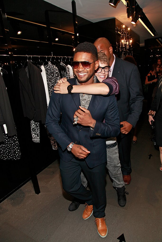 Justin Bieber hopped on Usher's shoulders.