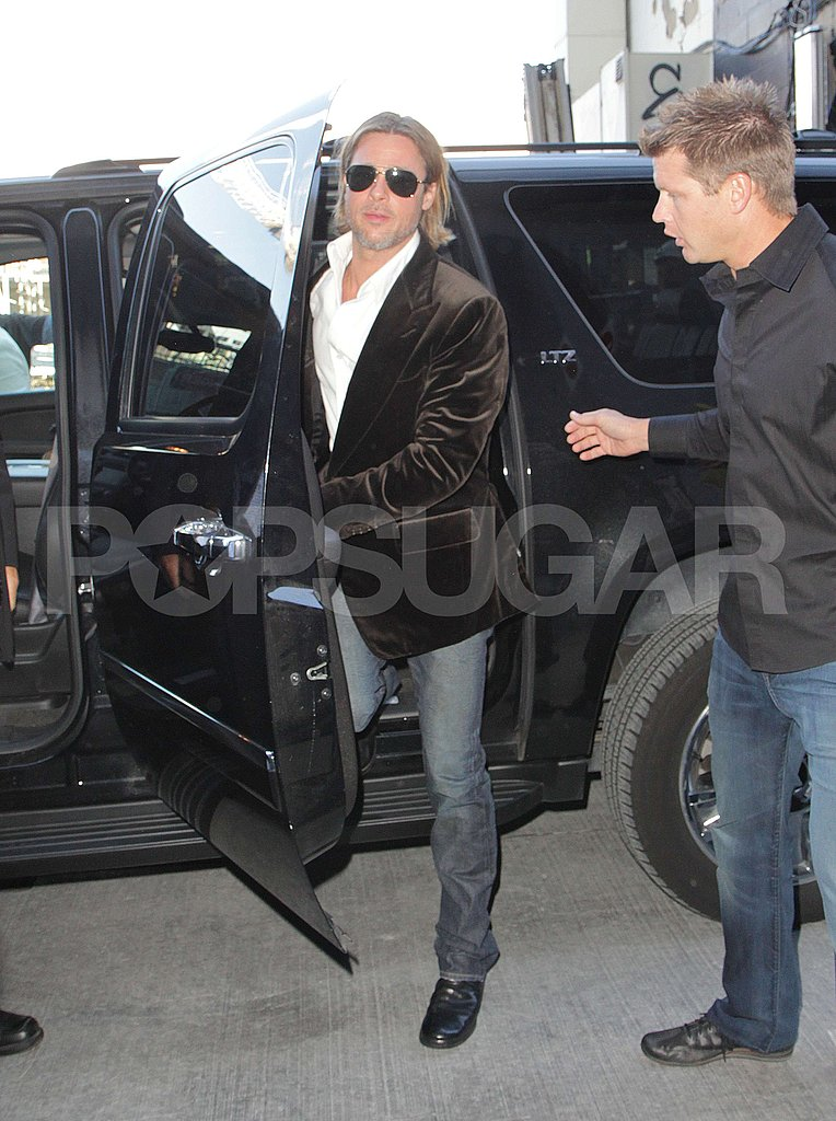 Brad Pitt arrived for the Moneyball press conference in Toronto Friday.