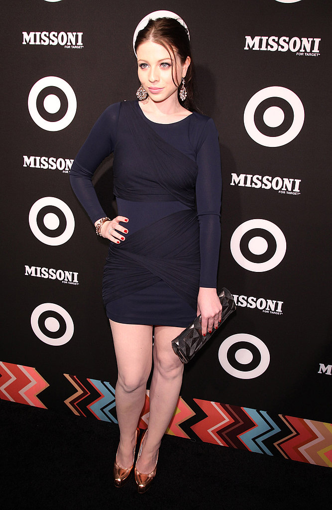 Michelle Trachtenberg in a navy blue dress.