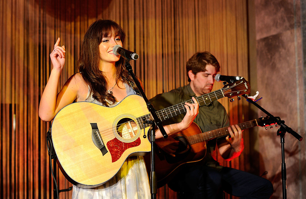 Leighton Meester playing guitar at Tiffany & Co.