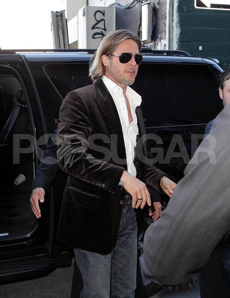 Brad Pitt greeted fans at Toronto Film Festival.