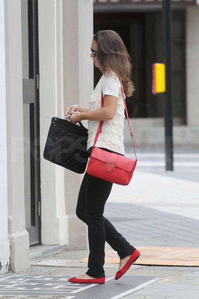 Pippa Middleton with a red bag.