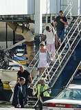 Britney Spears leaves a plane with Jason Trawick.