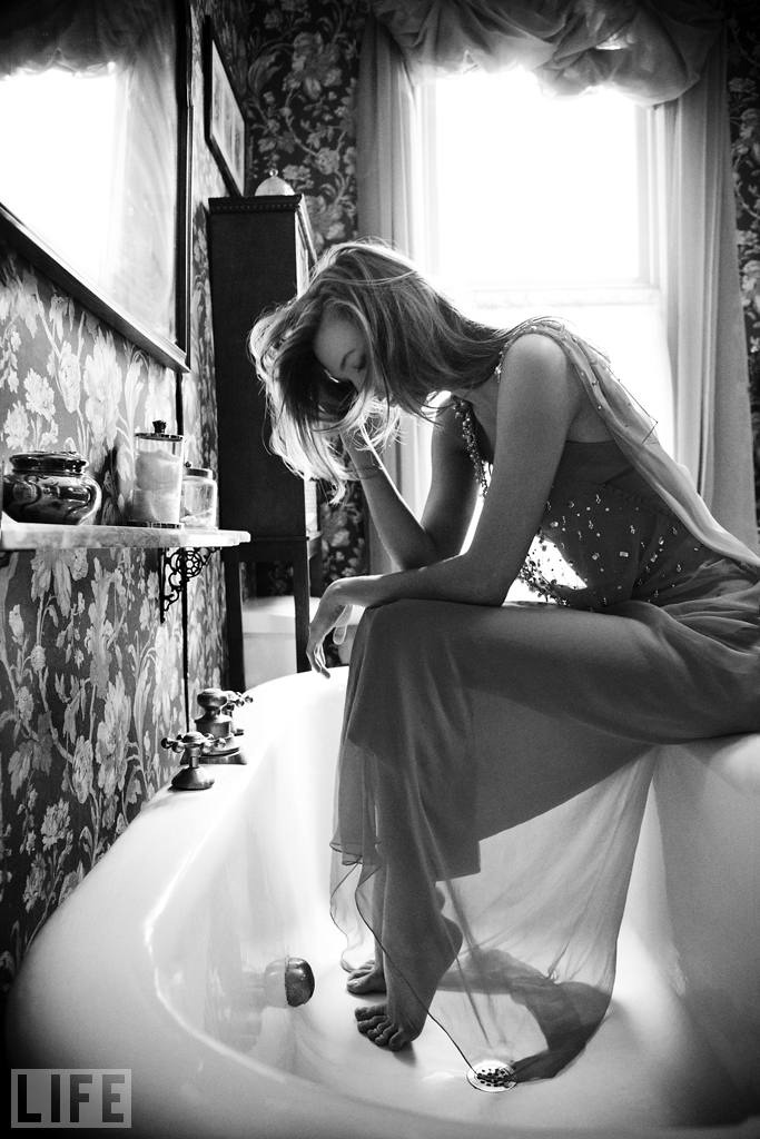 Karlie sits on the edge of the bathtub at her family's home in St. Louis before prom. She wore an orange chiffon Dior gown.  Gabrielle Revere/LIFE.com