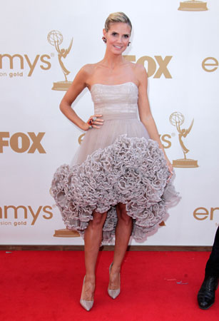 Project Runway host Heidi Klum wore a dress by show alum Christian Siriano.