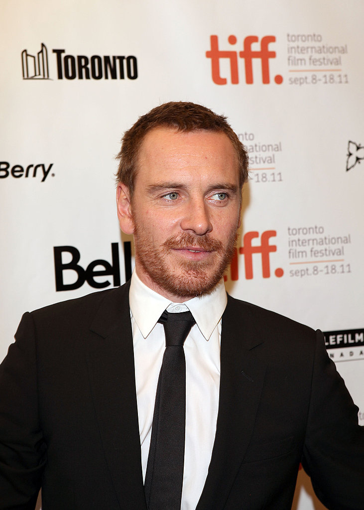 Michael Fassbender in a suit and tie.