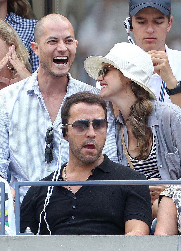 Keri Russell and Shane Deary sit behind Jeremy Piven at the US Open.