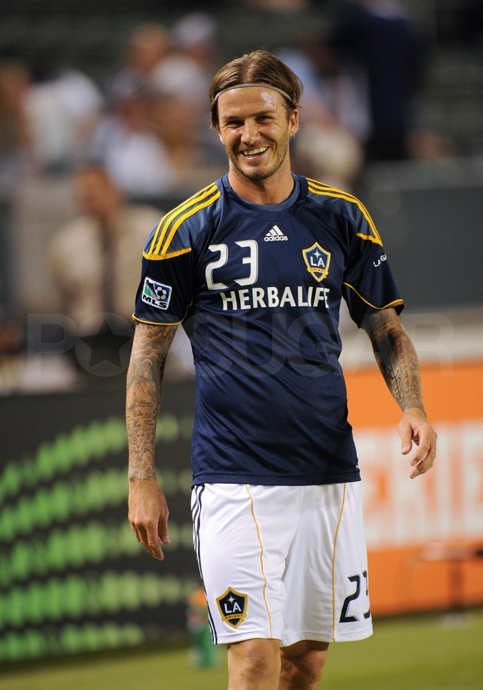 David Beckham smiled at his soccer game.