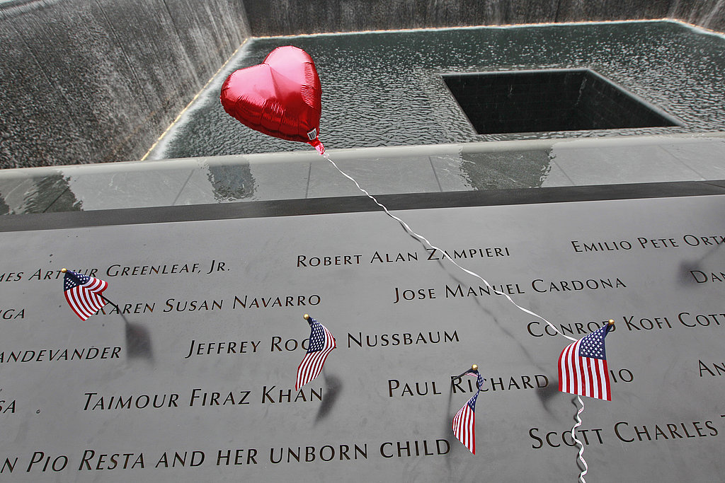 Small American flags and a heart-shaped balloon adorn the North Pool of the National 9/11 Memorial during the 10-year anniversary of the World Trade Center terrorist attacks.