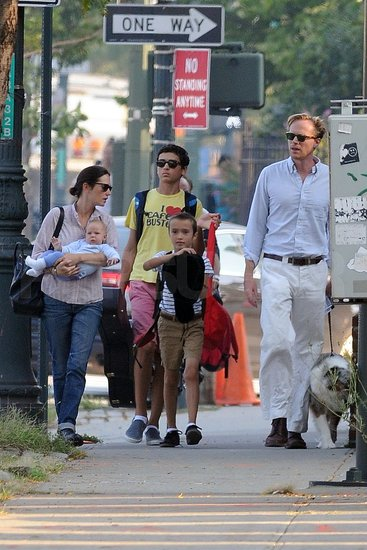 Jennifer Connelly, Paul Bettany, Agnes Bettany, and Kai Dugan watched Stellan Bettany play with a hat.