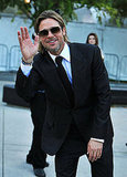 Brad Pitt waves at the Moneyball premiere during the 2011 Toronto International Film Festival.