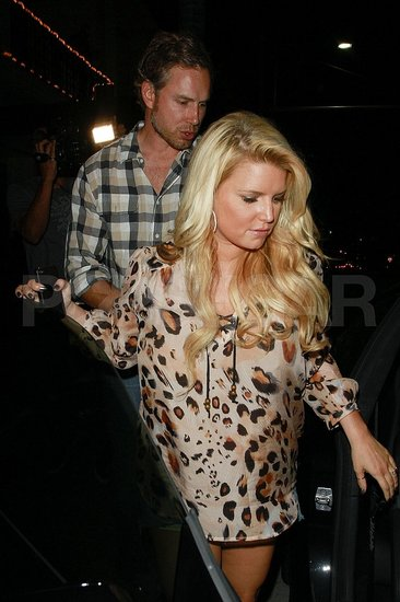 Jessica Simpson lead to her car by fiancé Eric Johnson.
