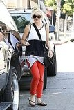 Gwen wore bright red pants for her day around town.
