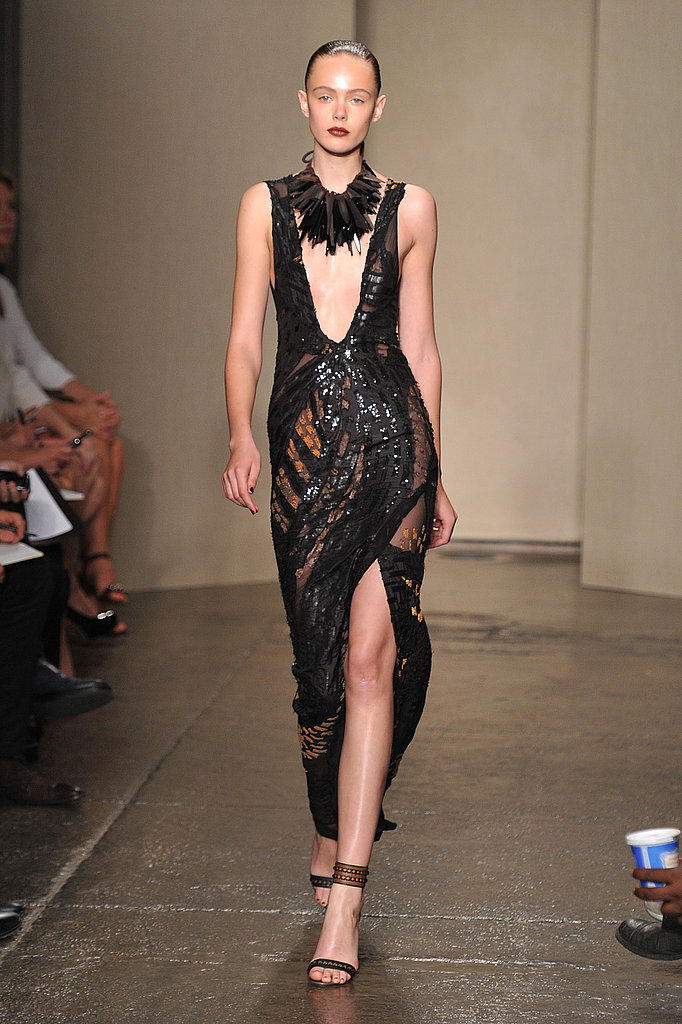 Donna Karan hit a severely sexy note with a neckline down to there on this embellished black evening gown.