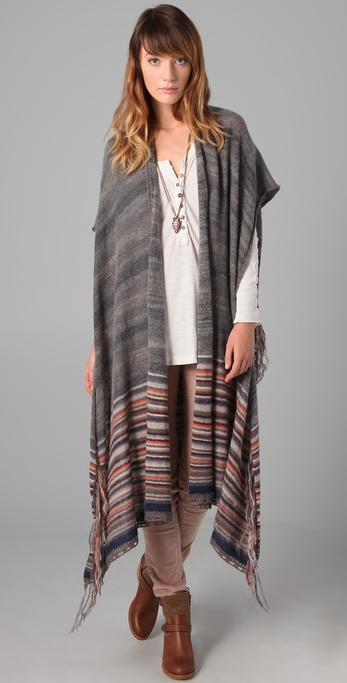 Rock a fun '70s aesthetic and wear this belted over wide leg jeans and platform loafers.  Free People Wandering Wrap Vest ($198)