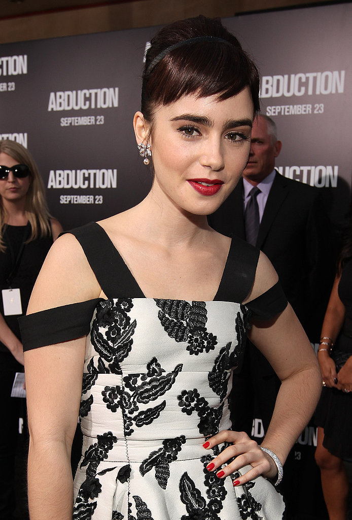 Lily Collins went vintage glam for the debut.