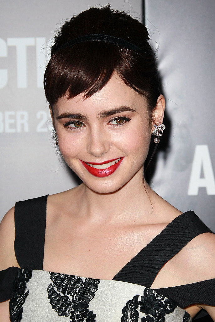 Lily Collins posed alone on the black carpet.