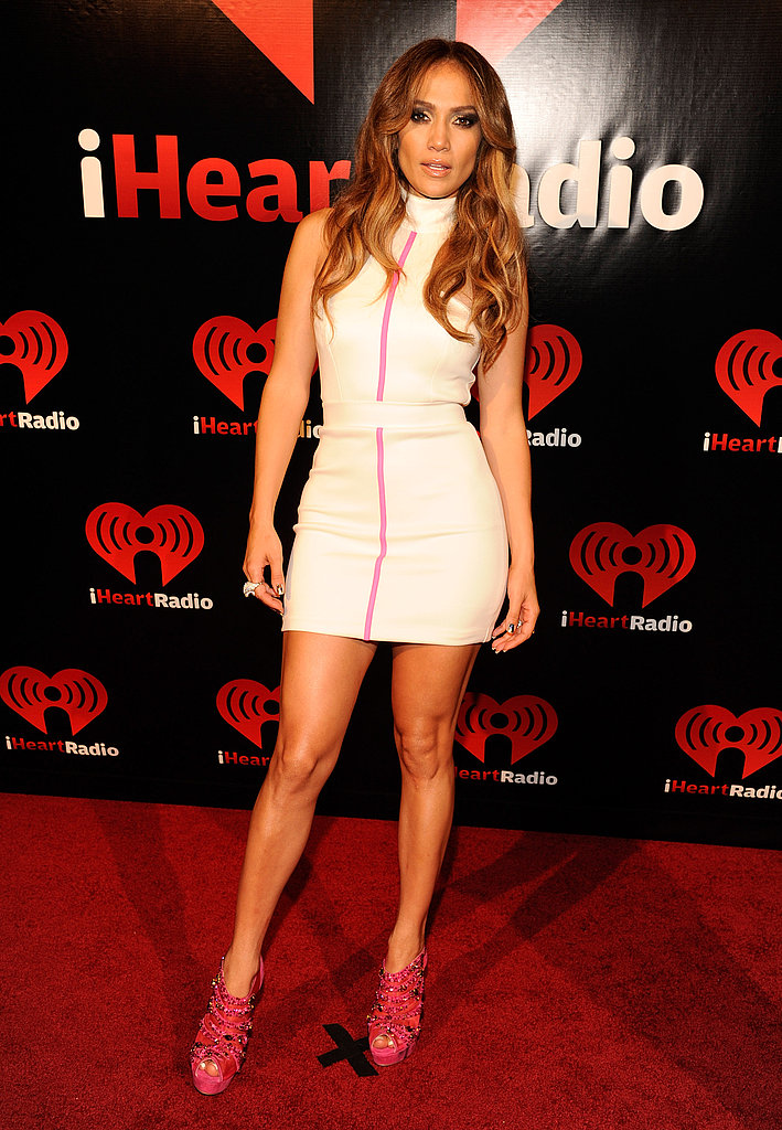 J Lo hit the red carpet in bright pink heels.