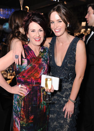 Megan Mullally and Emily Blunt smiled for photographers at the Governors Ball.