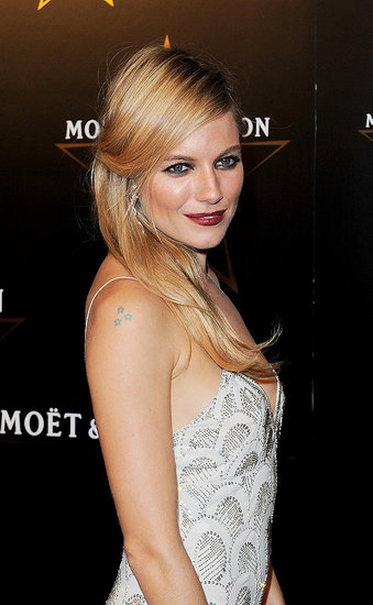 Sienna Miller at the Moet & Chandon Etoile Awards for Mario Testino.