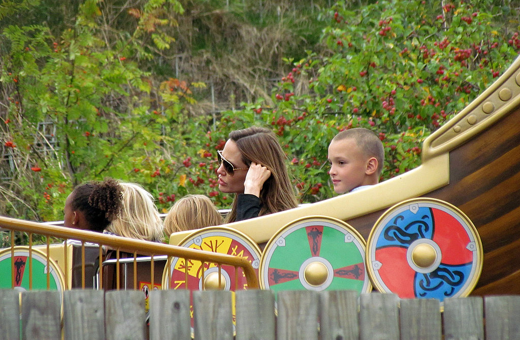 Angelina Jolie on a ride with her kids.