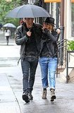 Jennifer Aniston and Justin Theroux together in the rain.