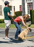 Jon Hamm and Jennifer Westfeldt with their dog.