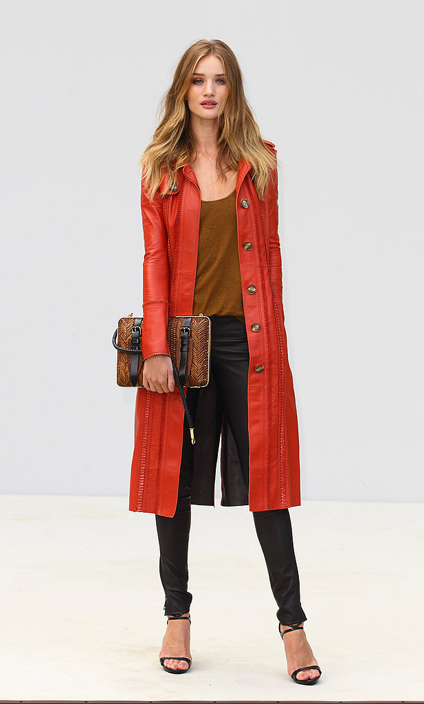 Rosie Huntington-Whiteley donned a striking red leather coat to the Burberry show.