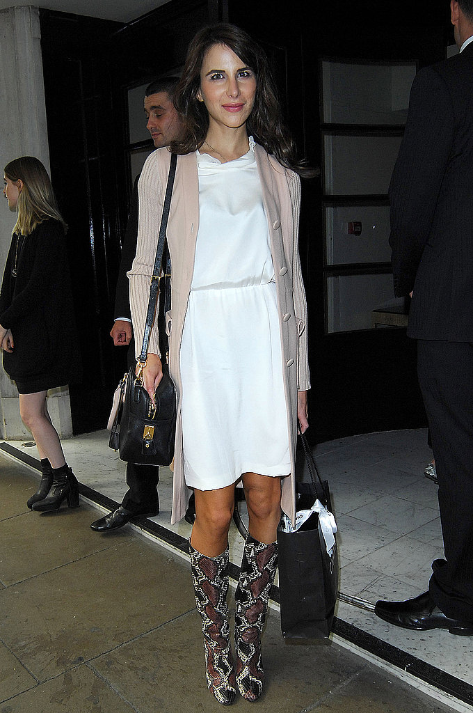 Stylist Caroline Sieber made her rounds around LFW in a white dress and funky boots.