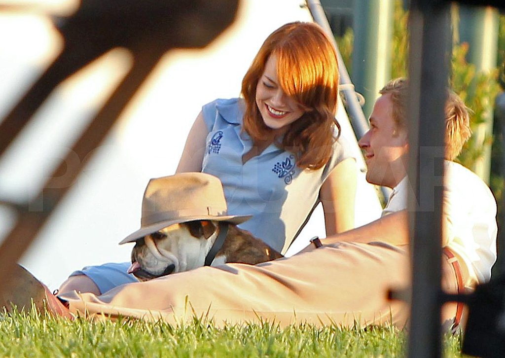 Ryan Gosling put his hat on a dog with Emma Stone on the set of The Gangster Squad.