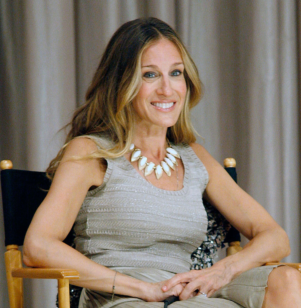 Sarah Jessica Parker lets her exotic House of Lavande statement necklace transform an understated gray ensemble.