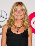 Heidi Klum introduces a tribal themed statement necklace to an all black look.