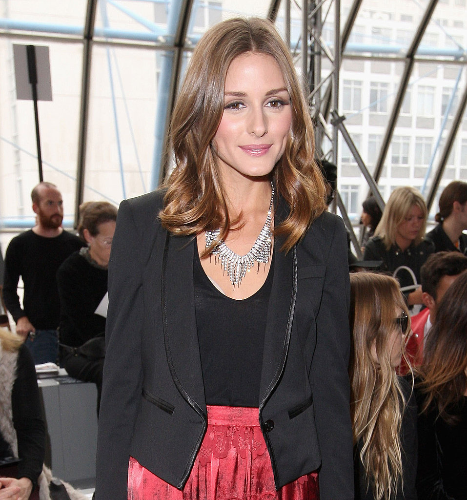 Olivia Palermo never fails to disappoint with major statement jewels, like this edgier piece that instantly lends a cool-girl cred to her tuxedo jacket and skirt.