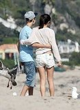 Justin and Selena hugged on the beach.