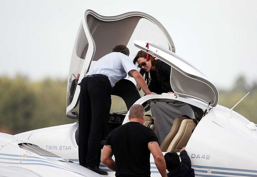 Angelina Jolie boards a plane.