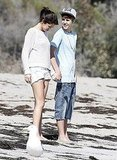 Justin and Selena slipped off their shoes and dug their toes into the sand.