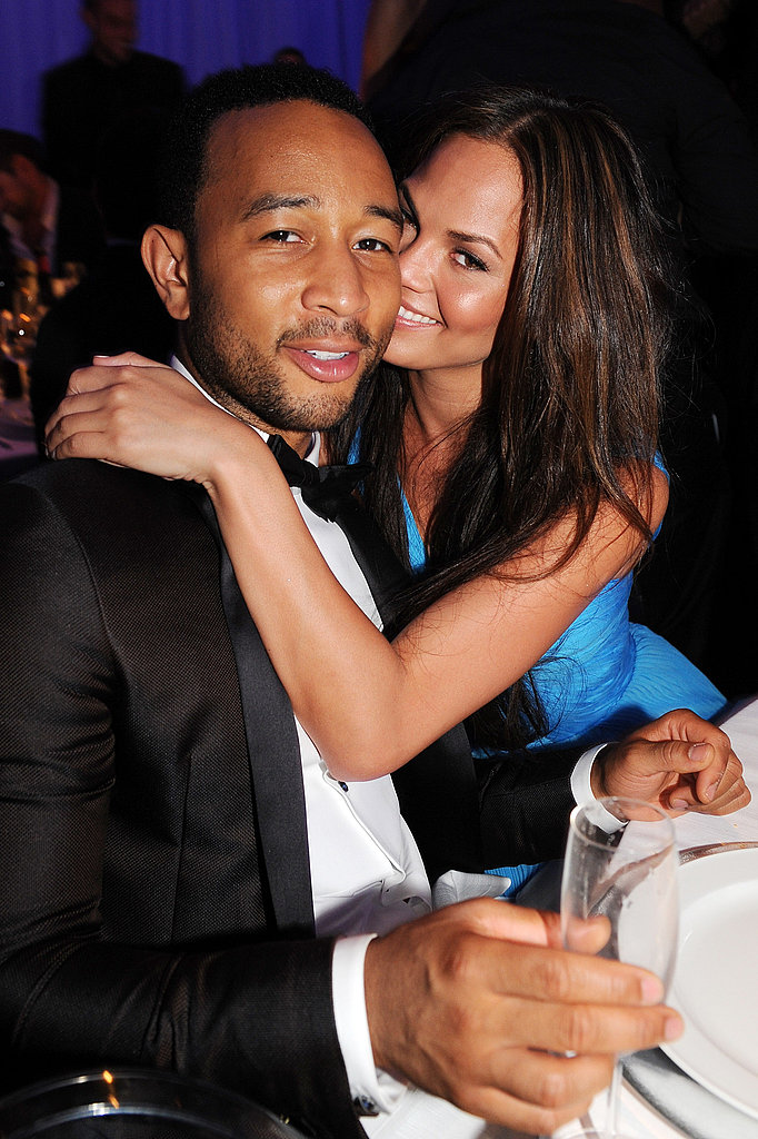 Chrissy Teigen gave John Legend a kiss and a hug.