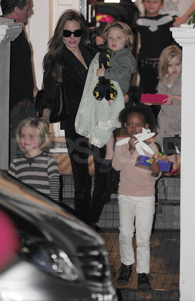 Angelina Jolie carries Knox Jolie-Pitt from Gwen Stefani's London home with Shiloh Jolie-Pitt, Zahara Jolie-Pitt, and Vivienne Jolie-Pitt.